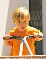 Toddler boy in cart