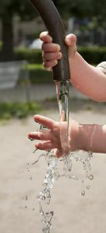 Toddler hands playing with water