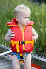 Toddler in a water safety jacket