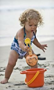 Toddler with bucket and spade